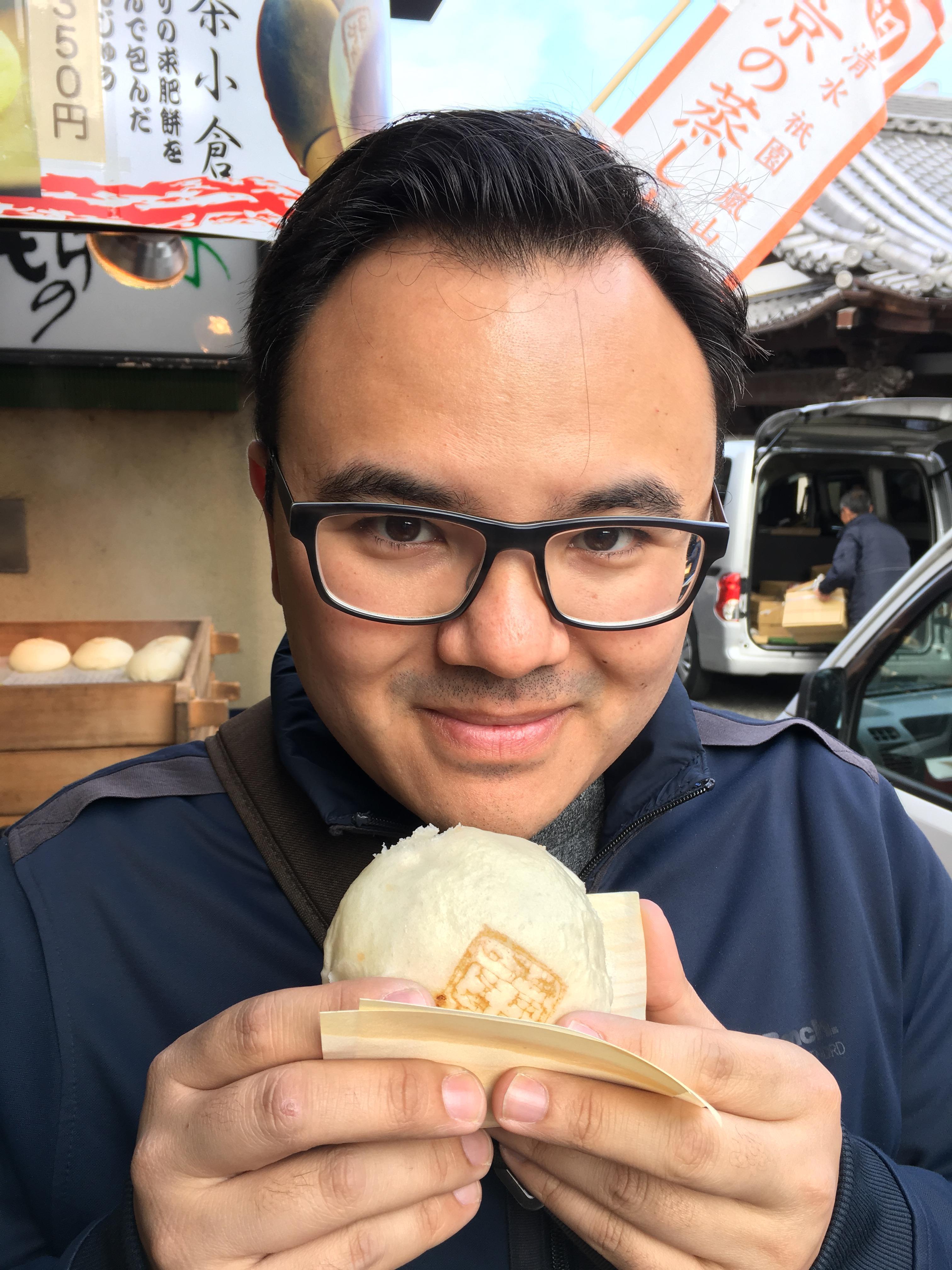 Sage holding a pork bun in Kyoto