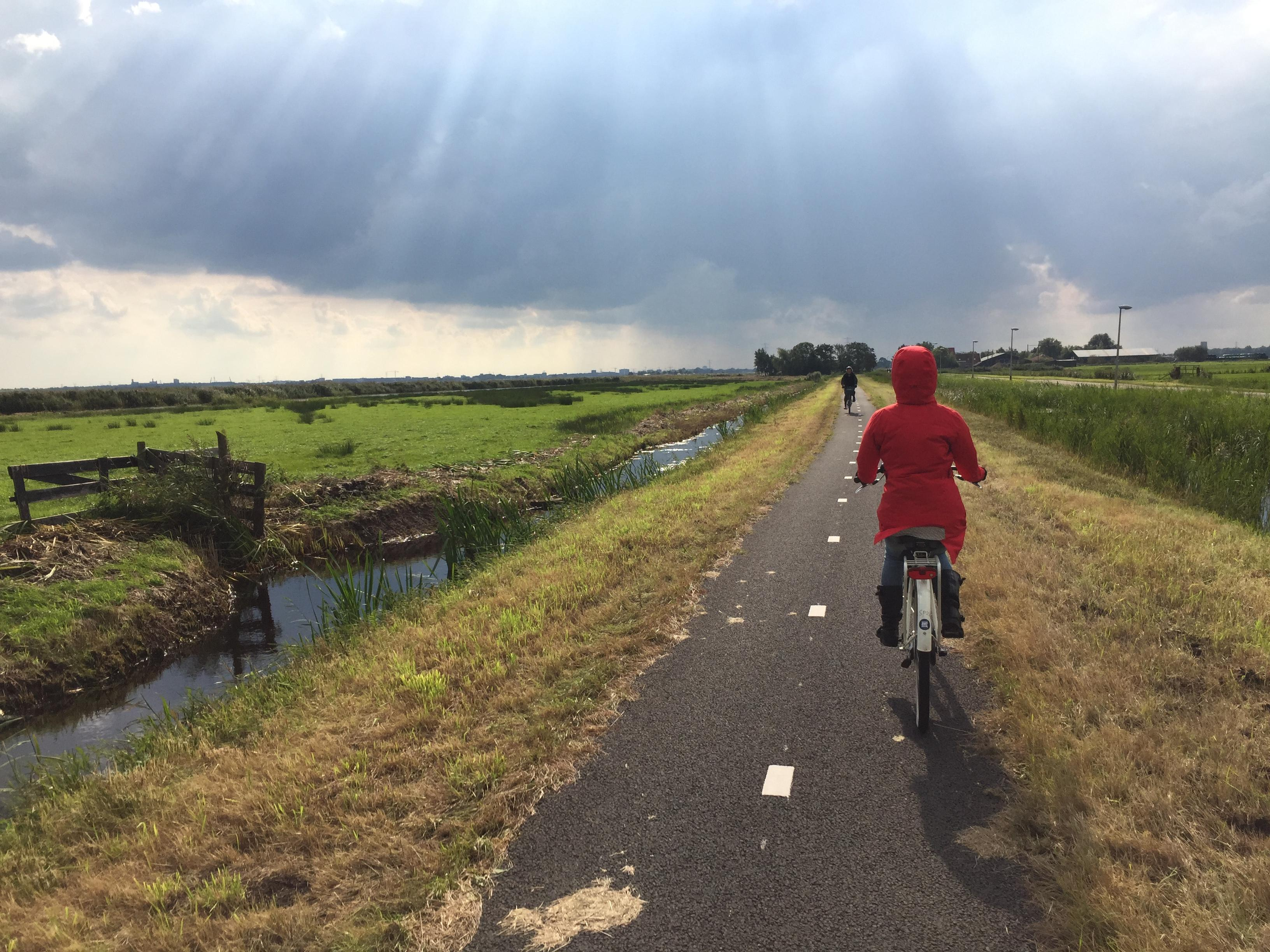 Alice riding a bike in Amsterdam-Noord